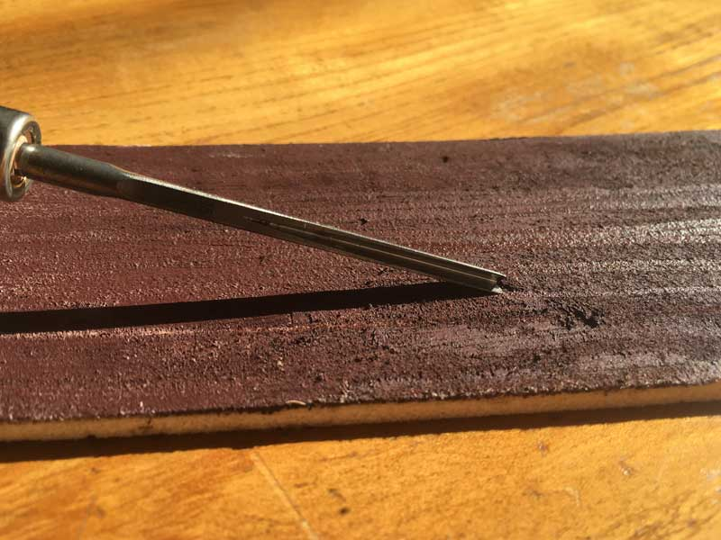 Sharpening lino cutting tools with a strop - sharpening a v shaped tool